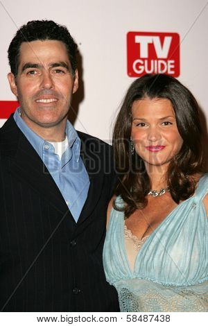HOLLYWOOD - AUGUST 27: Adam Carolla and wife Lynnette at the TV Guide Emmy After Party August 27, 2006 in Social, Hollywood, CA.
