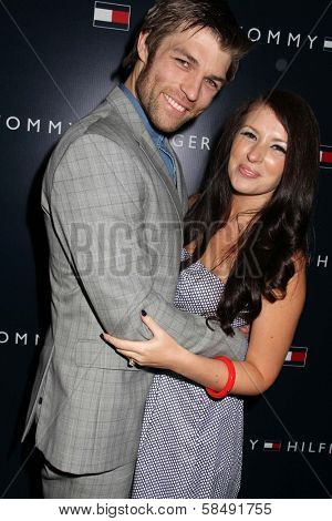 Liam McIntyre, Erin Hasan at the Tommy Hilfiger West Coast Flagship Grand Opening Event, Tommy Hilfiger, West Hollywood, CA 02-13-13