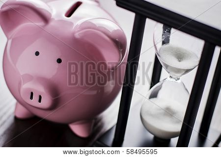Piggy Bank With An Hour Glass