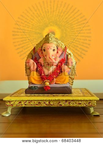 A clay statue of an Indian god Lord Ganesha. poster