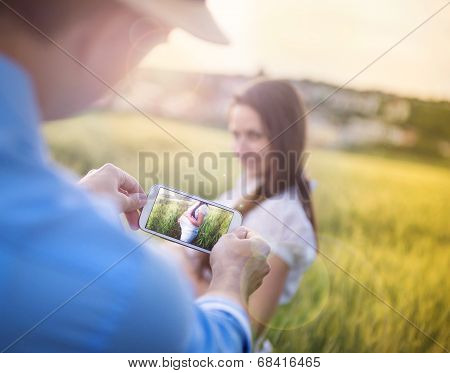 Taking picture of pregnant woman