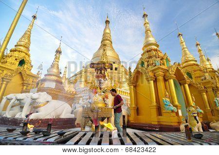 Rangoon, Myanmar - October 11, 2013: Buddhist People Visit Shwedagon Pagoda In Rangoon.