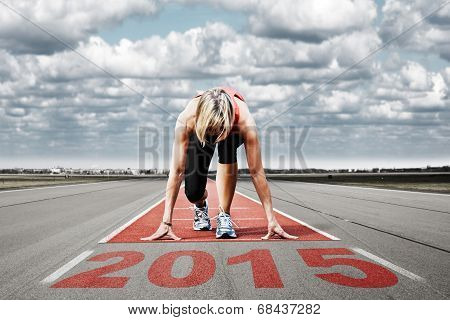 Female sprinter waiting for the start on an airport runway.In the foreground perspective view of the date 2015. poster