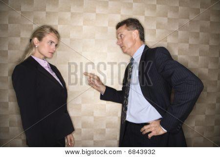 Businessman Reprimanding Businesswoman