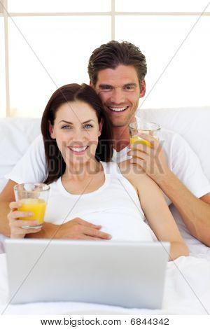 Smiling Couple Drinking Orange Juice