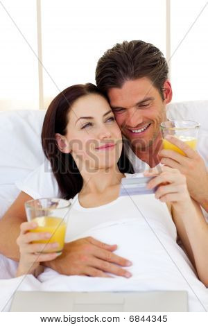 Intimate Couple Drinking Orange Juice