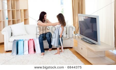 Mother And Her Daughter At Home After Shopping
