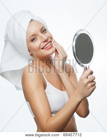 closeup portrait of attractive  caucasian smiling woman blond isolated on white studio shot lips toothy smile face hair head and shoulders looking at camera blue eyes towel mirrow cleaning cotton disc