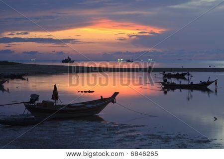 Boats At Sunset.