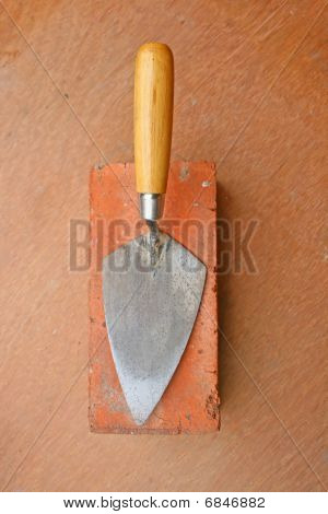 trowel and brick.