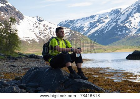 Sportsman On Mountains Lake