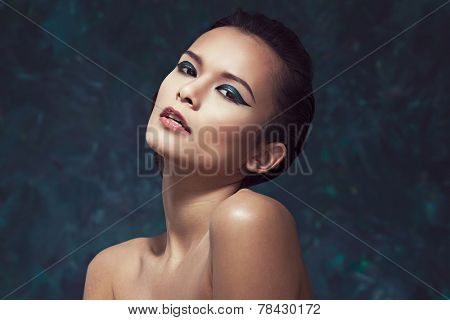 Beautiful young woman with bright creative makeup