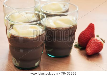 Tasty pudding and fresh strawberries on the table. poster