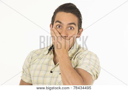 young handsome hispanic man posing surprised