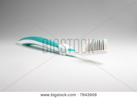 Toothbrush At Light Background