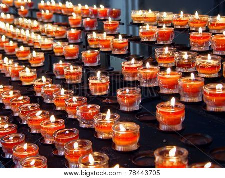 Red Candles In A Curch