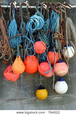Buoys hanging to dry on a wall
