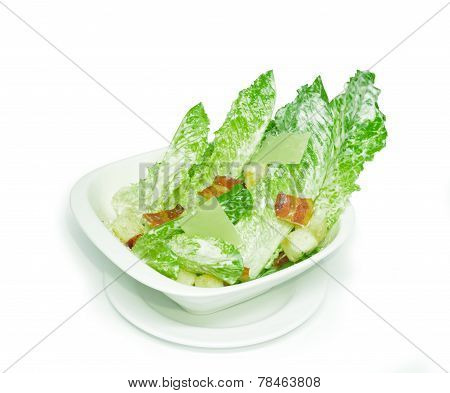 Caesar salad on white cup