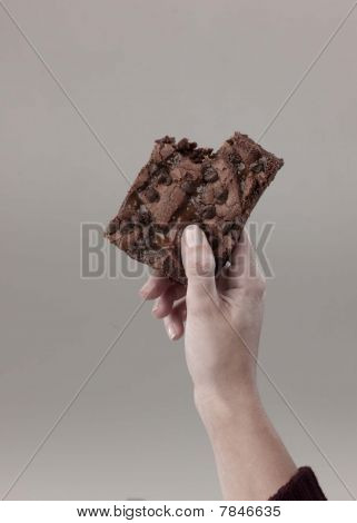 woman holds brownie