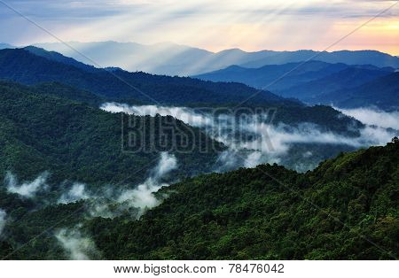 Sunset and ray over mountain hills
