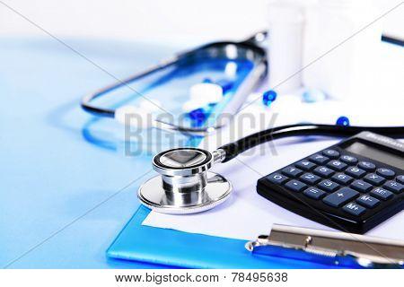 Stethoscope on light blue background