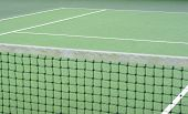 Tennis Net with selected focus with the court in shot poster