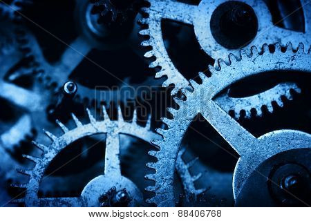 Grunge gear, cog wheels background. Concept of industrial, science, clockwork, technology. Blue tint.