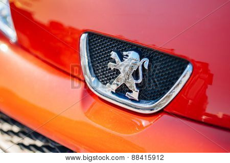 Peugeot Logo On A Red Car