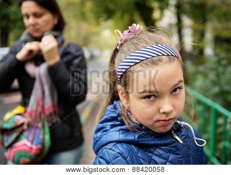 Quarrel. Mom and her sad daughter.