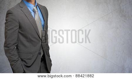 Impersonal portrait of a businessman against a grey concrete background