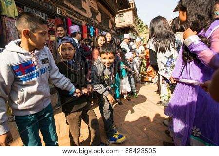 BHAKTAPUR, NEPAL - CIRCA DEC, 2013: During Birthday celebration head of family - 77 years 7 months 7 days 7 hours old, like rebirth according to Newar.