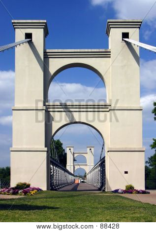 Historic foot bridge in Waco, Texas over the Brazos River. poster