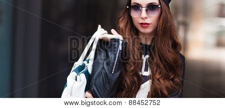 The Fashionable Young Girl In Sunglasses