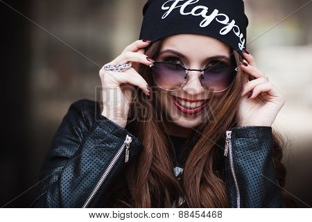 The Fashionable Laughing Young Girl In Sunglasses