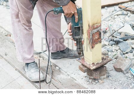 Close Up Detail Of Worker Drilling Holes In Steel Construction With Electric Drill