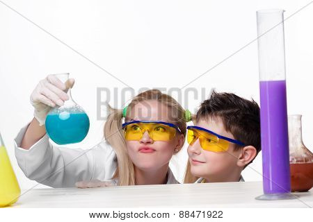 Teen and teacher of chemistry at chemistry lesson making experiments isolated on white background poster