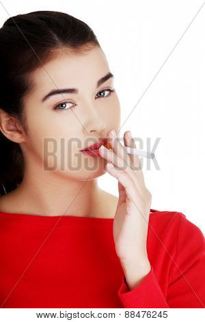 poster of Young addicted woman smoking cigarette.