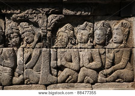 Ascetic men. Stone bas relief from the Borobudur Temle in Central Java, Indonesia.