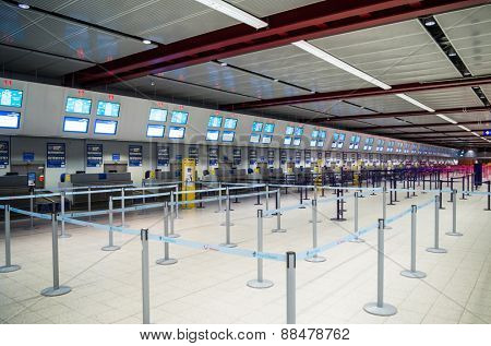 LONDON, UNITED KINGDOM - April 12, 2015: Interior with empty check-in lines on Luton airport in London, UK