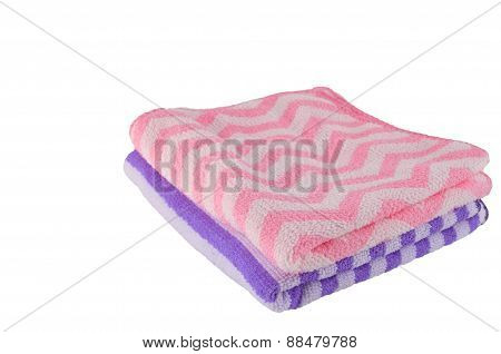 Purple and pink bath-towel stacking on white background