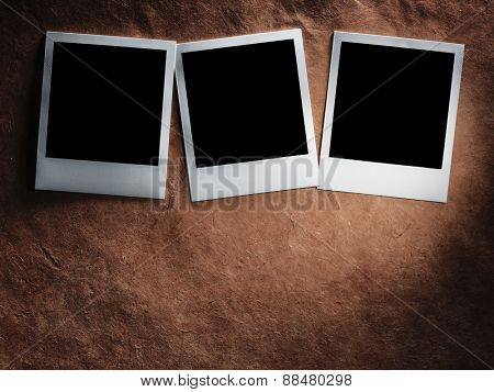 polaroid style photo frames on the very vintage paper