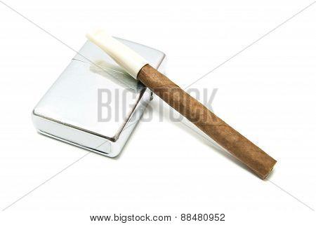 Single Cigarillo And Metal Lighter