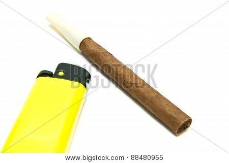 Single Cigarillo And Plastic Lighter
