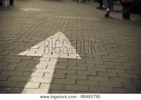 Arrow Sign On The Street Go Straight