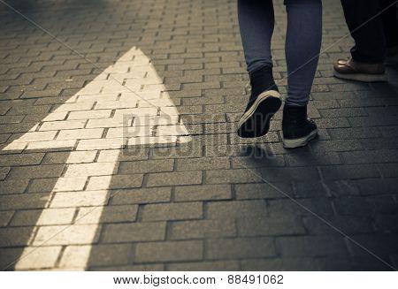 Arrow Straight On Street With Walking People In Dark Vintage Tone