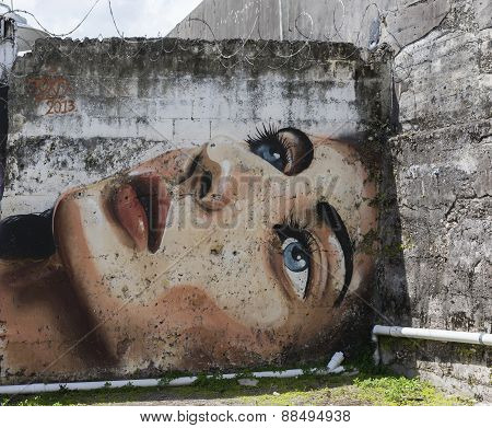 Graffiti Of Blue Eyed Woman Face.