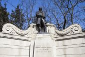 A statue of famous Civil Engineer Isambard Kingdom Brunel located along the Victoria Ebankment in London. poster