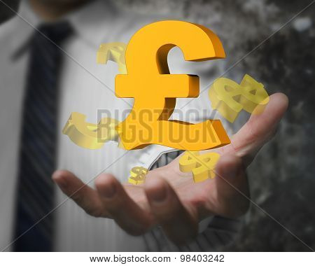 Businessman Hand Showing Pound Sterling Symbol With Dollar Signs