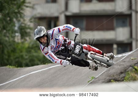 ST. PETERSBURG, RUSSIA - AUGUST 6, 2015: Unidentified biker on the berm in the BMX race Cruiser. The competitions is a stage of the BMX racing championship of Russia