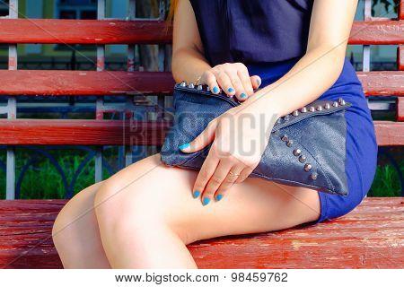 Fashionable stylish young woman with black handbag